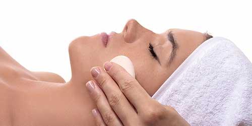 Woman receiving a facial or peel